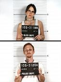 stock photo of mug shot  - Police mug shots of a male and female criminal holding a placard - JPG