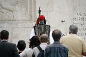 stock photo of evzon  - People watching a presidential guard during the guard change in Athens Greece - JPG