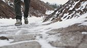 Close-up Of Male Legs In Winter Shoes Walking On Snow. Footage, View Of Walking On Snow With Snow Sh poster