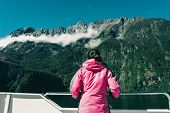 Woman Tourist On Ship Deck In Milford Sound poster