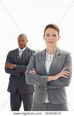 Serious businesswoman standing in front of businessman