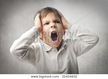 Angry child screaming