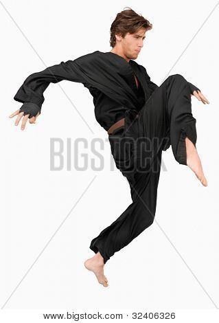 Side view of martial arts fighter attacking with his knee against a white background