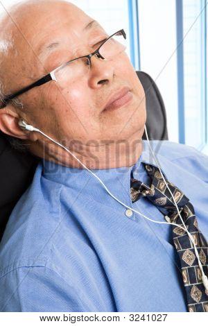 Relaxed Senior Asian Businessman