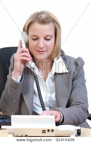 Young woman takes a telephone call
