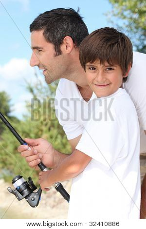 Man and little boy fishing