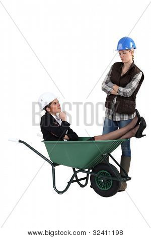 Unhappy tradeswoman distraught at finding an engineer in her wheelbarrow