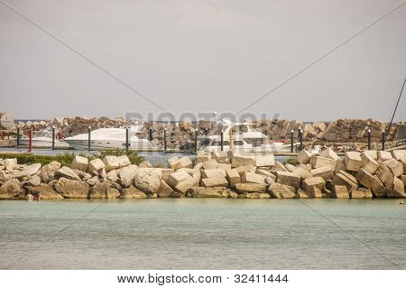 White Yachts Inisde Stone Seawall