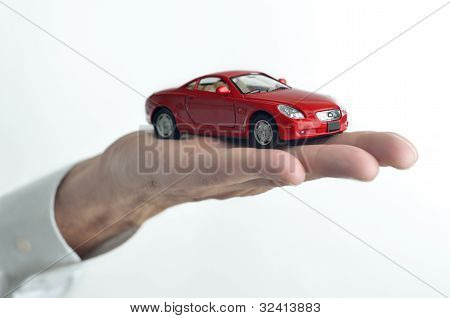 Man Holding A Toy Car On His Hand