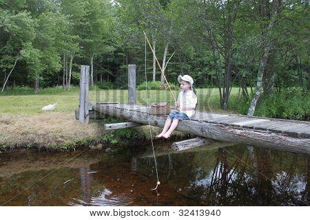 Boy Fishing on the Dock