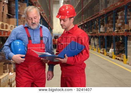 Senior Worker And Supervisor In Warehouse
