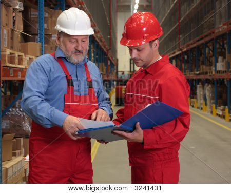 Workers Checking Invoice