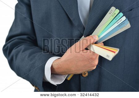 Businessman Holding Color Guide Book Isolated On White Background