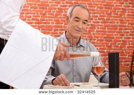 retiree at restaurant with sommelier