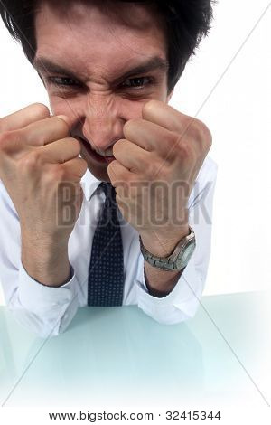 Frustrated businessman clenching his fists