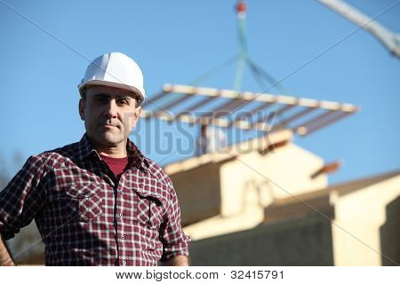 Foreman overseeing construction of house