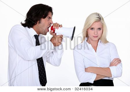 Man shouting into a woman's ear