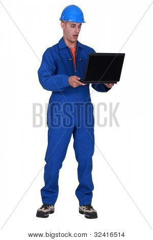 Plumber astonished by laptop