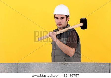 Construction worker holding a mallet
