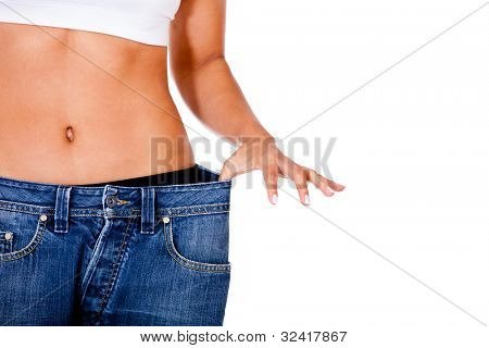 Thin woman in big pants - weight loss concepts