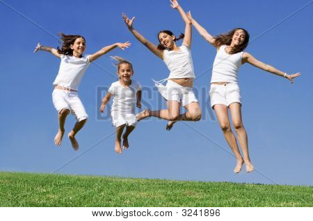 Group  Of Happy Kids Jumping For Joy