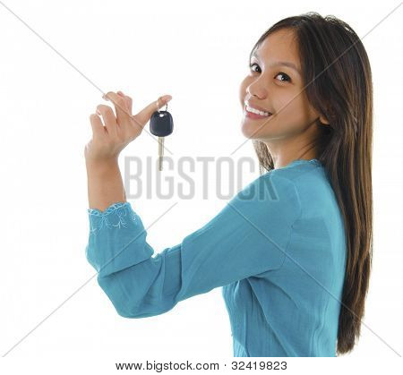 Young pan asian teen holding her first car key on white background