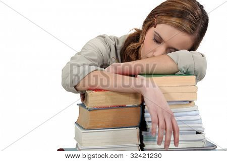 Female student asleep on her books