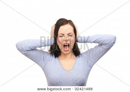 Portrait of a unhappy young woman covering her ears and screaming. Isolated on white background