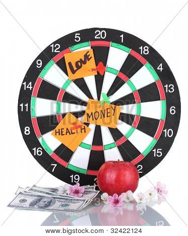 Darts with a stickers symbolizing love, health and money isolated on white