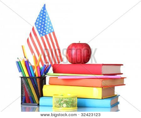 Composition of the school supplies, American flag and an apple isolated on white