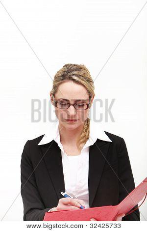 Efficient Businesswoman Taking Notes