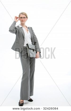 Stylish Businesswoman Adjusting Her Glasses