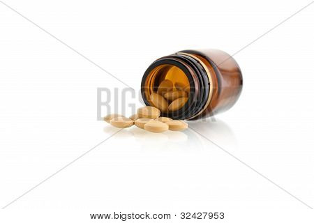 Tablets & Bottle Isolated On White Background