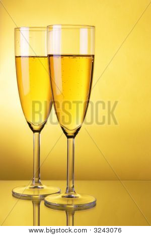 Champagne Over Yellow Background