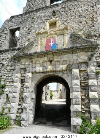 Arched Stone Entrance At A French Castle