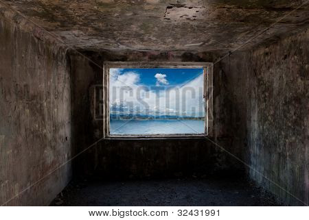 Dark old room with window with sea behind him