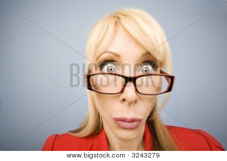 Shocked Woman In Red Making A Funny Face