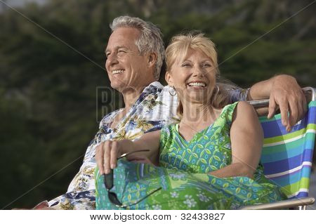 Smiling Middle-Aged Couple Relaxing