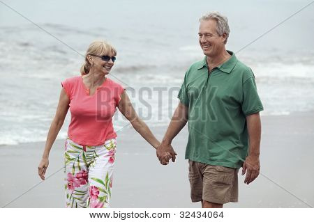 Couple Walking Hand in Hand on Beach