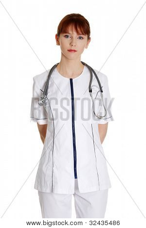 Serious nurse or young female medical doctor isolated on white background.