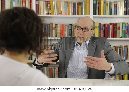 woman talking to a psychologist, consultant or advisor