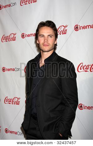 LAS VEGAS - APR 26:  Taylor Kitsch arrives at the CinemaCon 2012 Talent Awards at Caesars Palace on April 26, 2012 in Las Vegas, NV