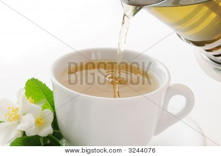 Cup With Flowing Tea