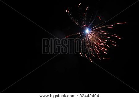 single large red explosion at a fireworks