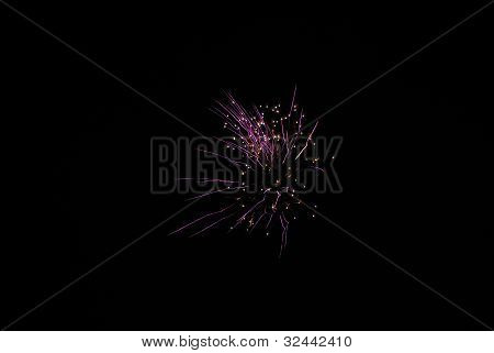 single high purple explosion at a fireworks