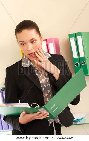 Surprised business woman in her office