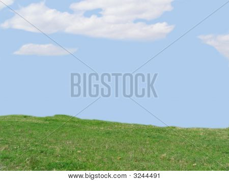 Field With Blue Sky And Clouds