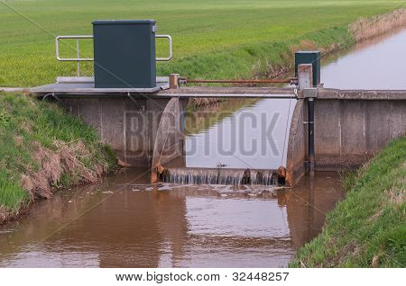 Closeup Of A Weir In A Ditch