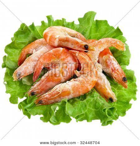Fresh shrimp on a salad lettuce isolated on white