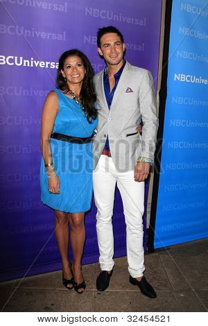 PASADENA - APR 18:  Dina Eastwood, Emile Welman arrives at the NBCUniversal Summer Press Day at The Langham Huntington Hotel on April 18, 2012 in Pasadena, CA